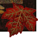 Flaming maple leaves drift on the wind and carpet the forest floor