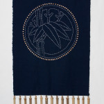 "This panel is based on the concept of Noren (short curtains hung in doorways in Japan), The fabric is antique Japanese Indigo 14"" wide and has bamboo segments hung along bottom edge as wind chimes."