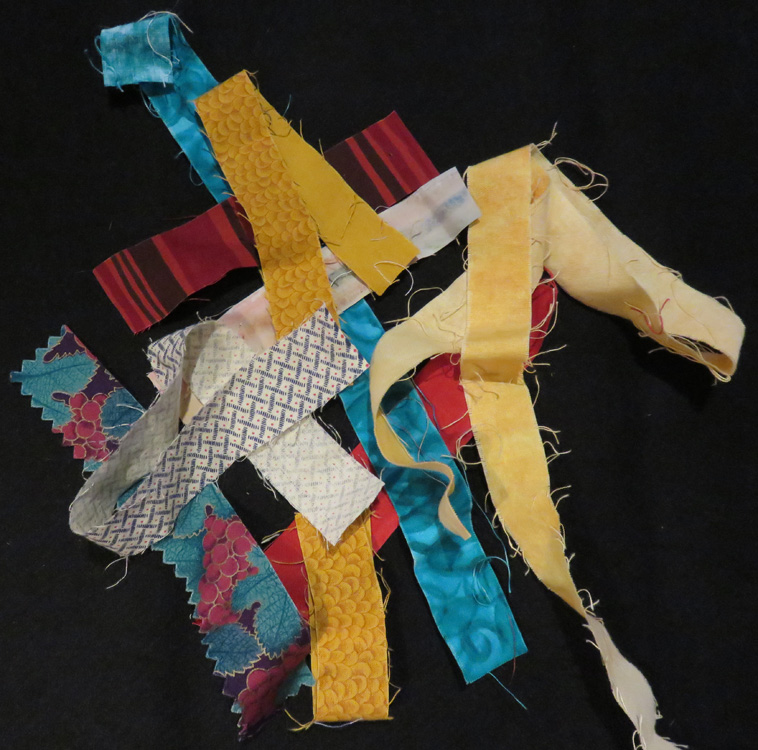 """Some of my really narrow fabric strips - most narrower than 1 1/2"""" wide."""