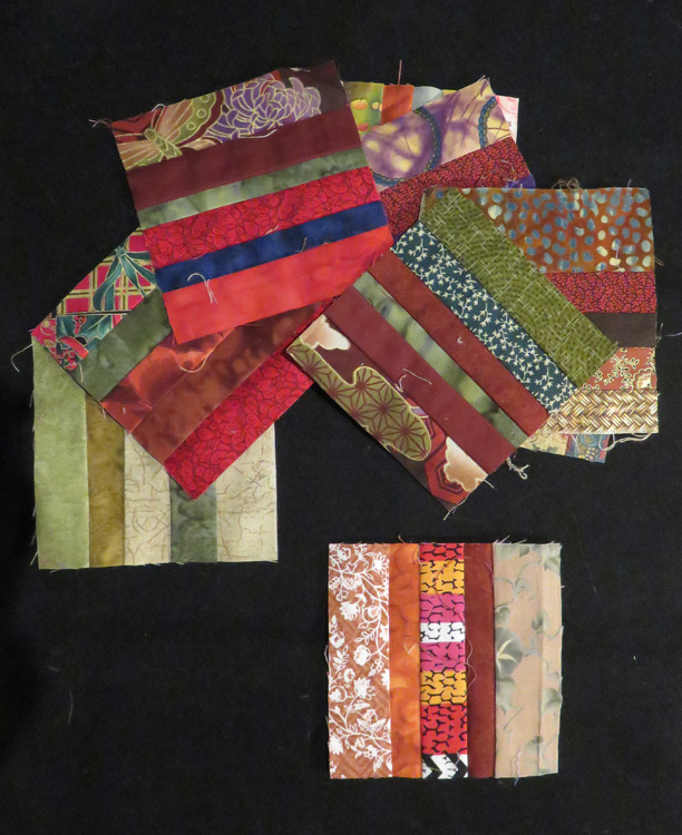 "The blocks are a riot of color - anything goes as long as the strips finish around 1/4"" wide. Narrower than that becomes difficult to deal with seam allowances"