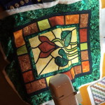 Stained Glass Quilt Cyclamen design being quilted