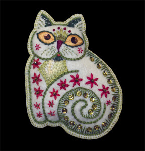 One of my embroidered Folk Art ornaments - the cat. I started making these felt ornaments back in the mid 1970s