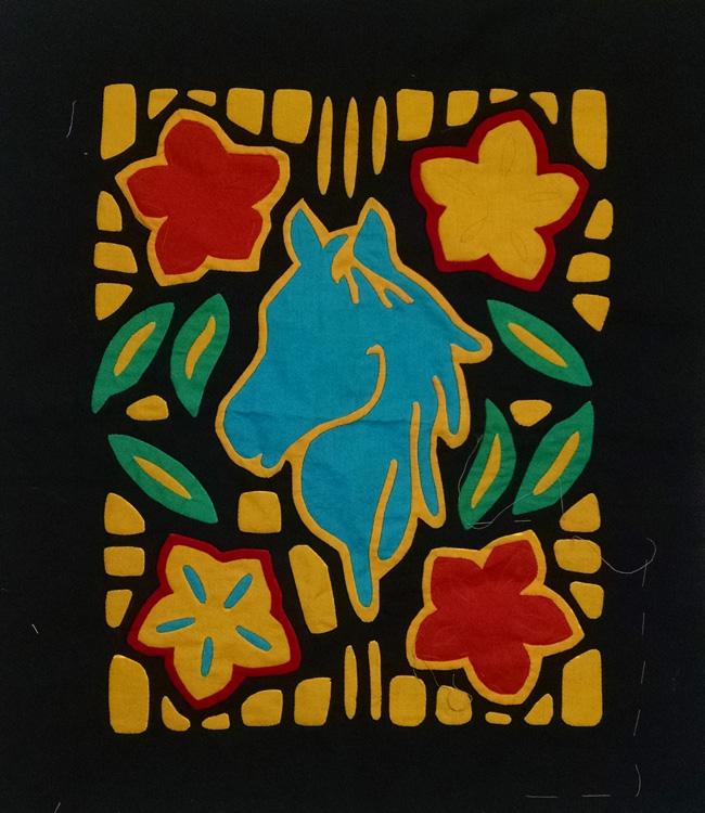 Yolanda's Mola featuring a horse