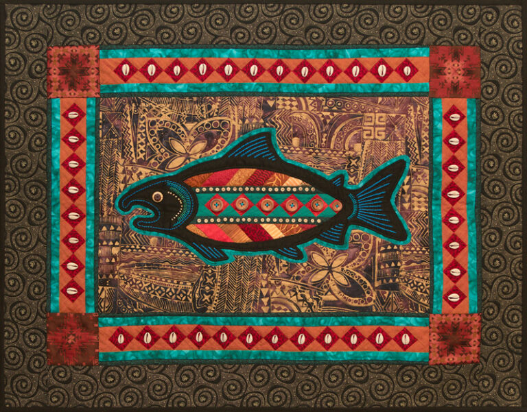 Appliqued Salmon with Seminole panel inset. Embellished with shells and hand embroidery.
