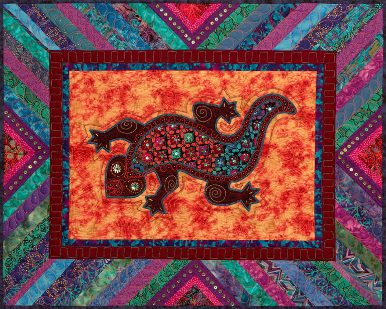 Appliqued Lizard with bold batik fabric inset. Embellished with beads and sequins.