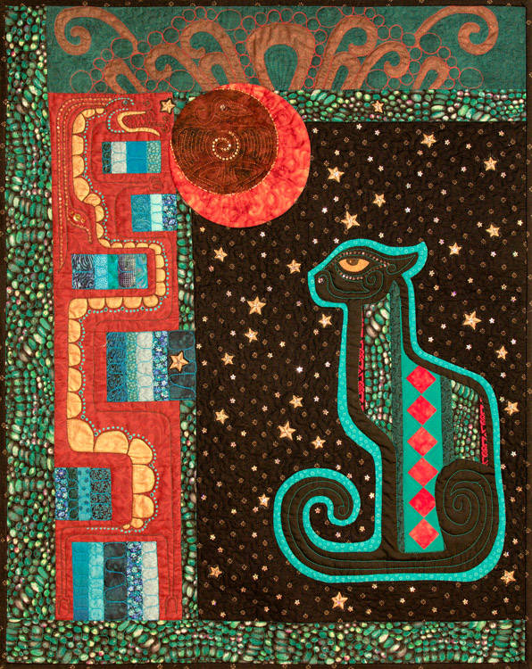 This quilt features an appliqued jaguar with a Seminole pieced panel inset, embellished with beads, sequins, and painted details.