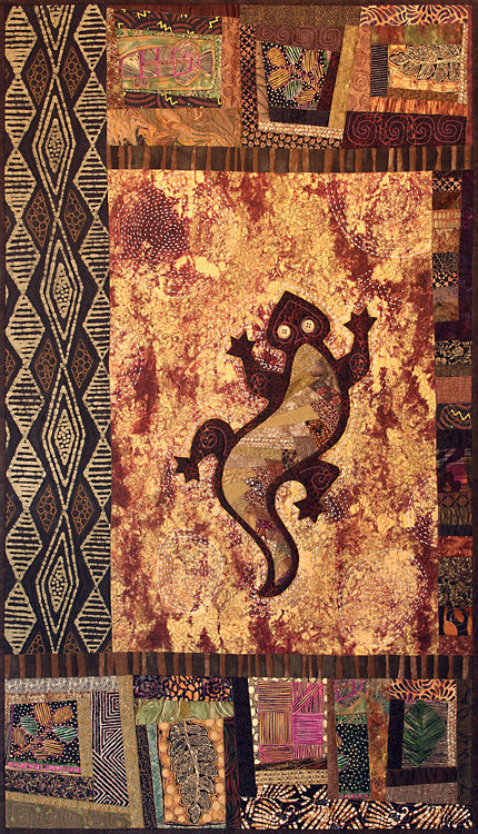 This quilt features an appliqued Lizard with a foundation strip-pieced inset, embellished with Big Stitch hand stitching.