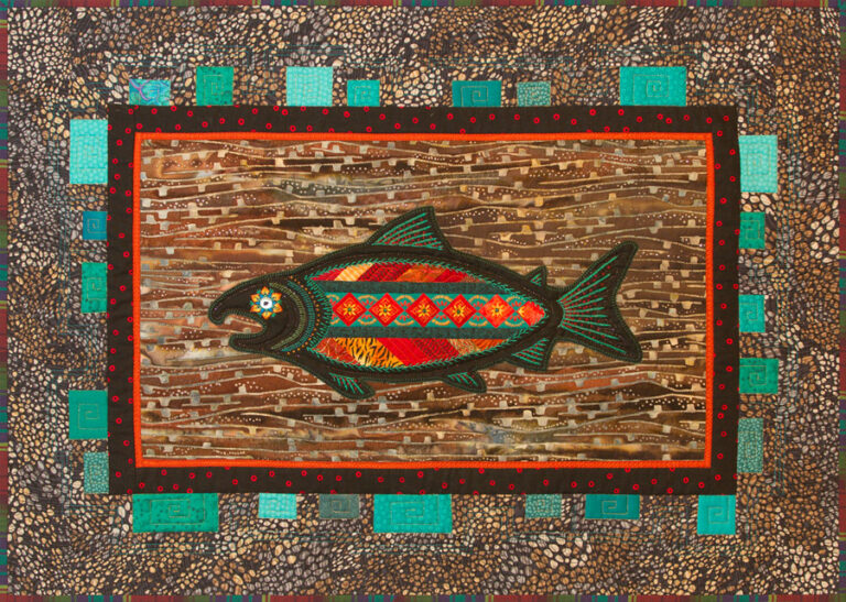 Appliqued Salmon with a Seminole pieced panel inset, embellished with hand embroidery.